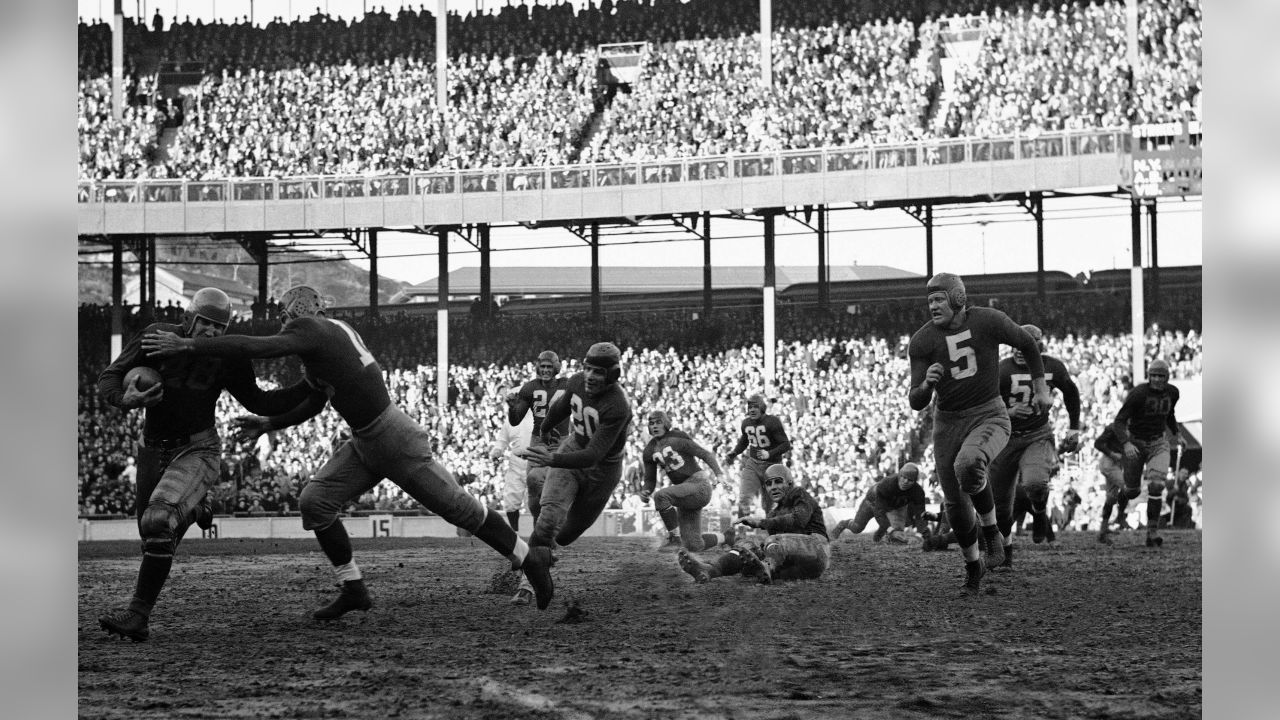 Chicago Bears back Beattie Feathers (48) is about to be tossed for loss by Giant Dale Burnett in game played on Oct. 31, 1937 at the Polo Grounds. Bears and Giants played to a 3-3 tie. (AP Photo)