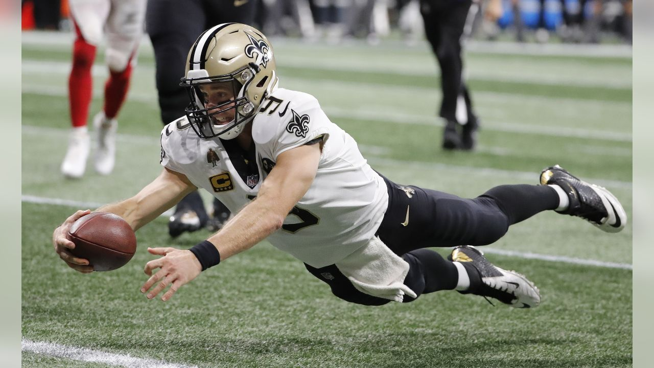 New Orleans Saints quarterback Drew Brees (9) dives into the end zone for a touchdown against the Atlanta Falcons during the second half of an NFL football game, Sunday, Sept. 23, 2018, in Atlanta. (AP Photo/David Goldman)