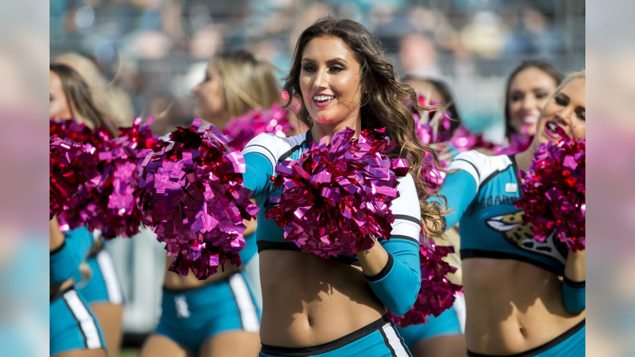 Member of the Jacksonville Jaguars Roar cheerleaders perform during the second half of an NFL football game between the Jacksonville Jaguars and the Houston Texans, Sunday, Oct. 21, 2018, in Jacksonville, Fla. (AP Photo/Stephen B. Morton)