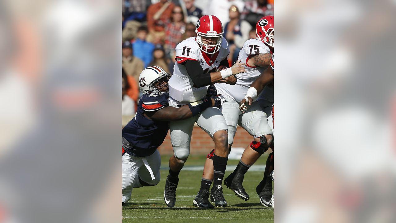 Georgia quarterback Greyson Lambert (11) drags Auburn defensive lineman Dontavius Russell (95) as he carries the ball during the second half of an NCAA football game, Saturday, Nov. 14, 2015, in Auburn, Ala. Georgia won 20-13. (AP Photo/Butch Dill)