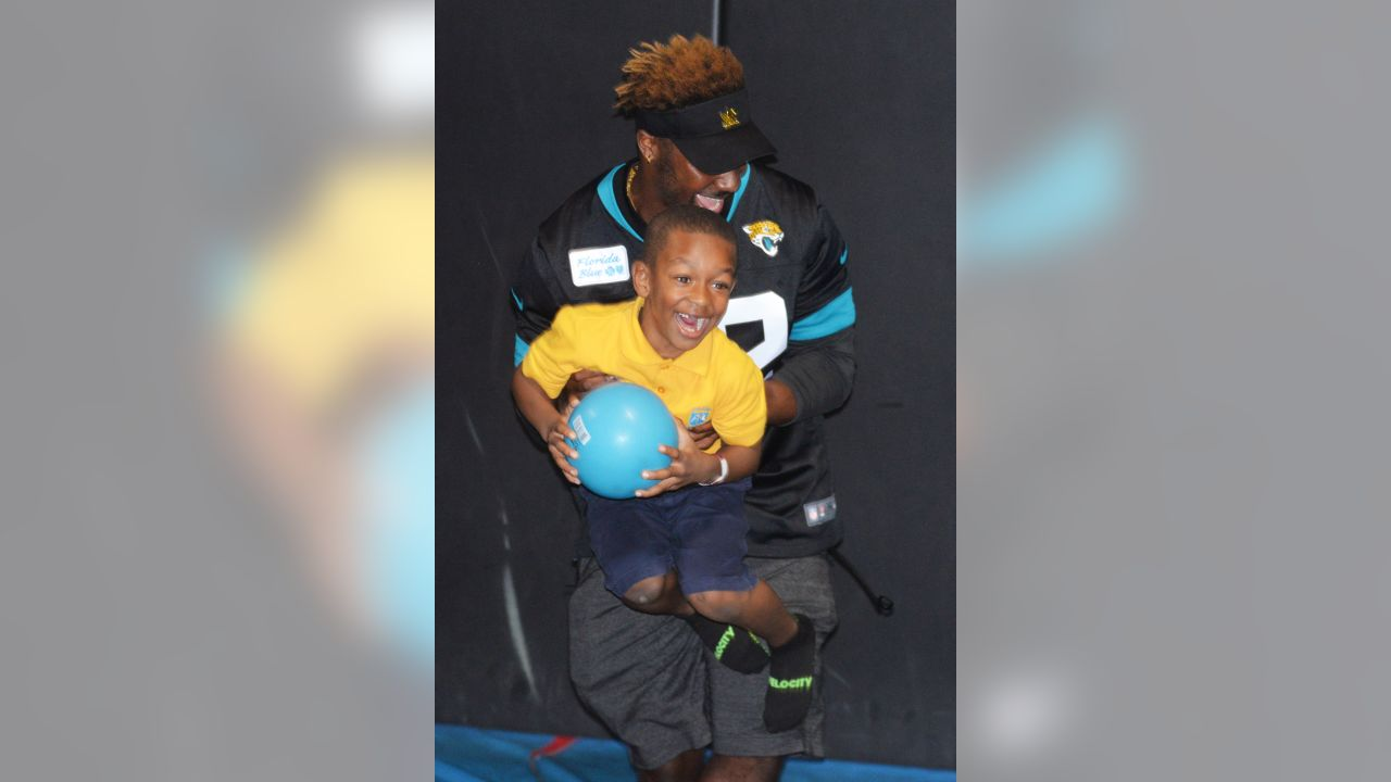 Jacksonville Jaguars players participate during the Crucial Catch Survivor Celebration against the Tuesday, October 16, 2018 at Flight Fit N Fun in Jacksonville, Fla. (Rick Wilson/Jacksonville Jaguars)