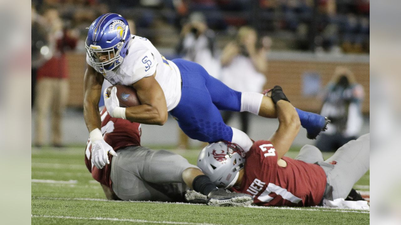 Washington State linebacker Peyton Pelluer (47) and safety Skyler Thomas, left, tackle San Jose State tight end Josh Oliver during the second half of an NCAA college football game in Pullman, Wash., Saturday, Sept. 8, 2018. Washington State won 31-0. (AP Photo/Young Kwak)