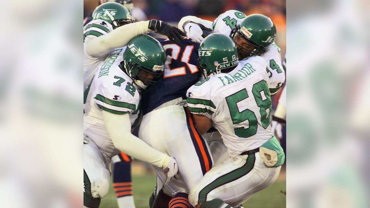 Chicago Bears running back Darnell Autry (21) is enveloped by New York Jets defenders Jason Ferguson (72) James Farrior (58) and Dwayne Gordon (52 during the second quarter Sunday, Nov. 16, 1997, in Chicago. The Jets defeated the Bears 23-15, to stay atop the AFC East.(AP Photo/Beth A. Keiser)