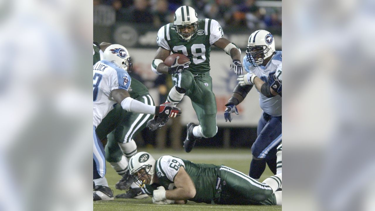 New York Jets' Curtis Martin, center, leaps over teammate Jason Fabini on his way to  a first down during the fourth quarter against the Tennessee Titans, 2003 in East Rutherford, N.J.. The Jets won 24-17. (AP Photo/Julie Jacobson)