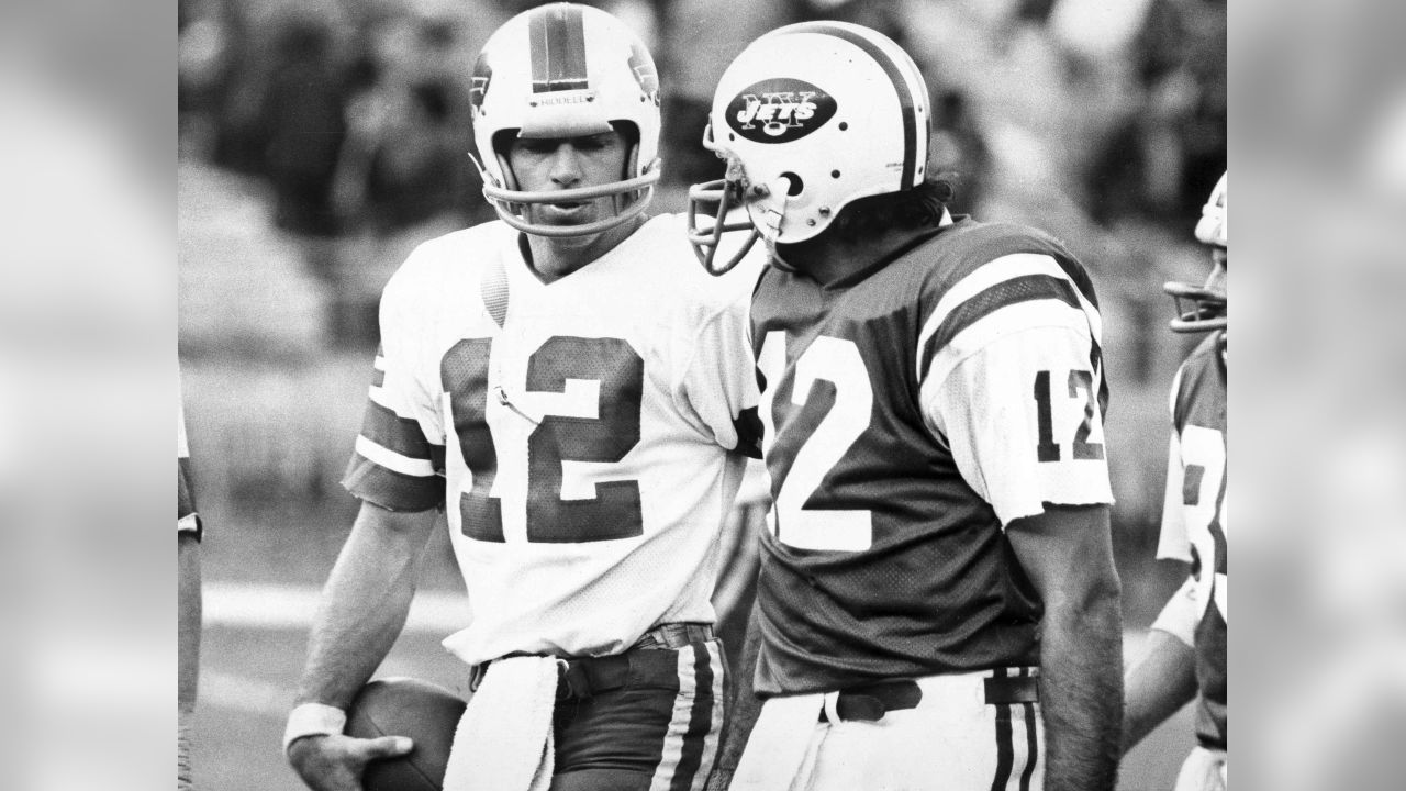 New York Jets quarterback Joe Namath, right, and Buffalo Bills quarterback Joe Ferguson, have each other's numbers as they walk off the field at New York's Shea Stadium in New York after the Bills squeaked through with the 24-23 victory, Nov. 2, 1975. (AP Photo/Ray Stubblebine)