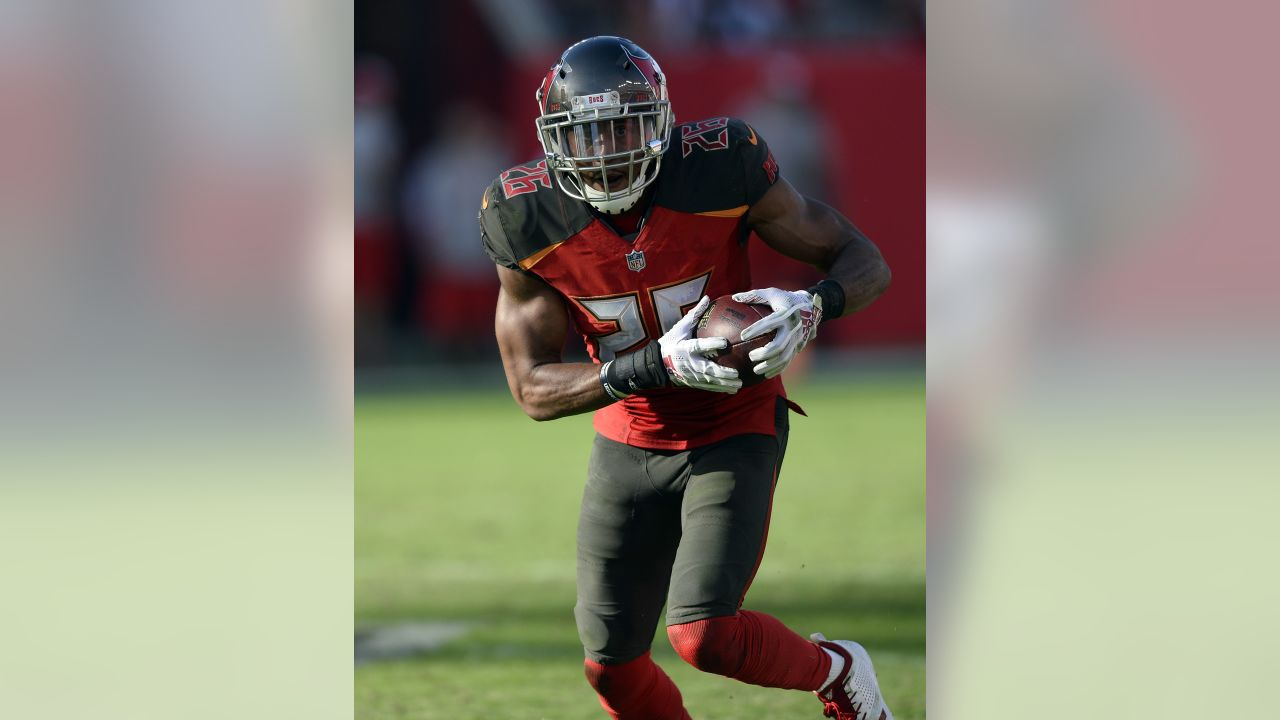 Tampa Bay Buccaneers defensive back Andrew Adams (26) runs with the football after intercepting a pass by Atlanta Falcons quarterback Matt Ryan during the second half of an NFL football game Sunday, Dec. 30, 2018, in Tampa, Fla. (AP Photo/Jason Behnken)