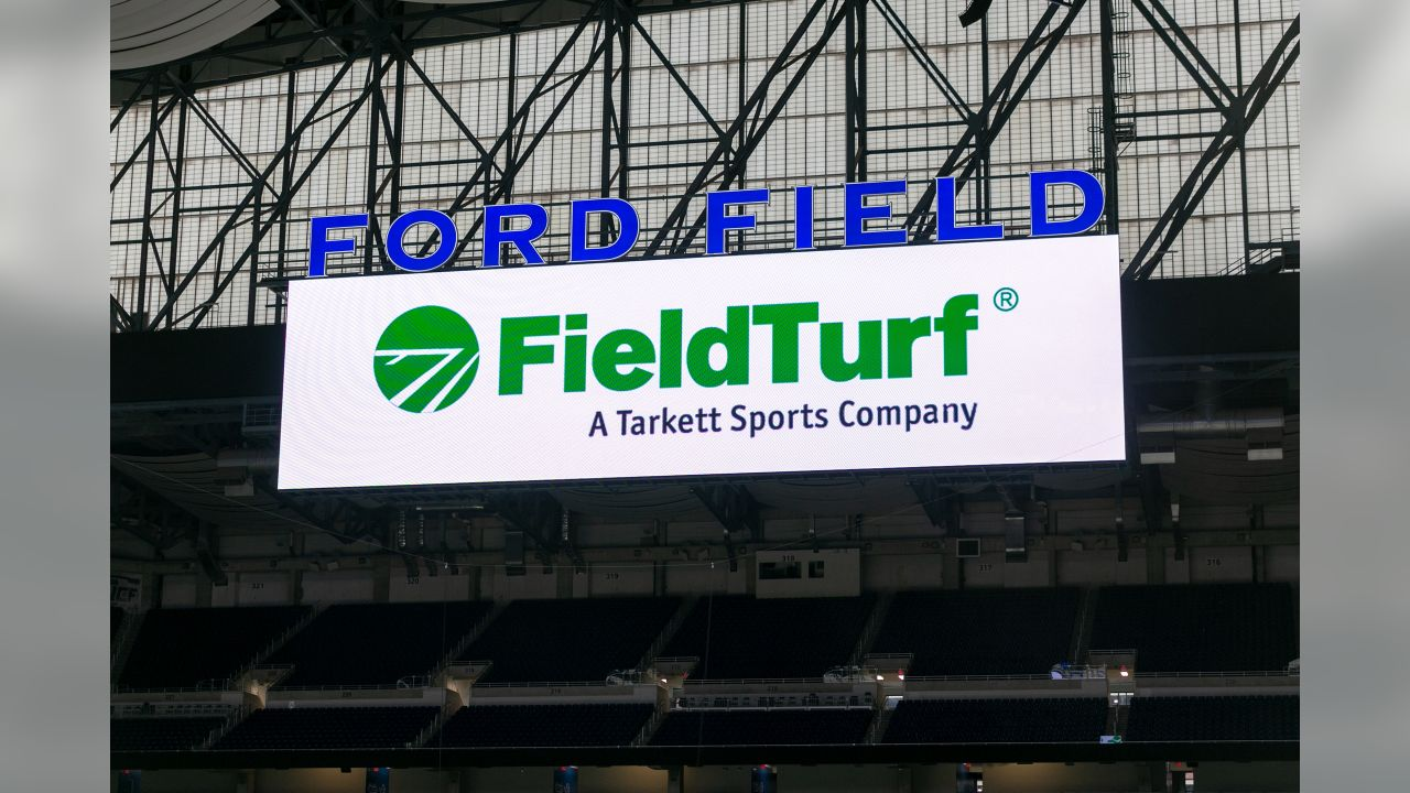FieldTurf is laid out at Ford Field on Thursday, May 9, 2019 in Detroit.
