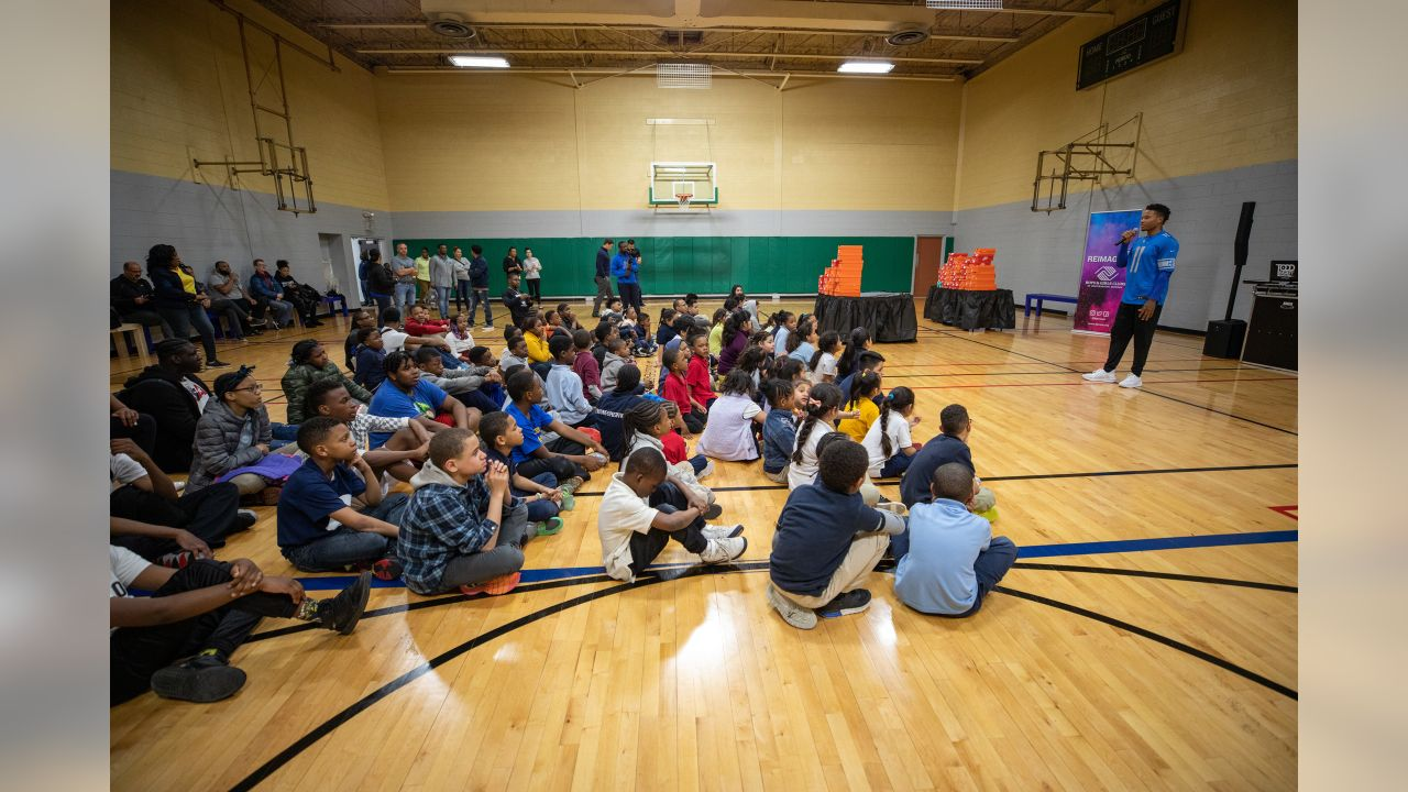 Detroit Lions wide receiver Marvin Jones Jr. (11) distributes new Nike shoes to kids at the Diehl Boys & Girls Club with a grant to his Dreambuilders Foundation on Wednesday, May 1, 2019 in Detroit. (Detroit Lions via AP)