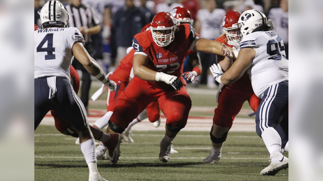 Fresno State's offensive lineman Micah St. Andrew, center, blocks for quarterback Marcus McMaryion against BYU during the second half of an NCAA college football game in Fresno, Calif., Saturday, Nov. 4, 2017. Fresno State won the game 20-13. (AP Photo/Gary Kazanjian)