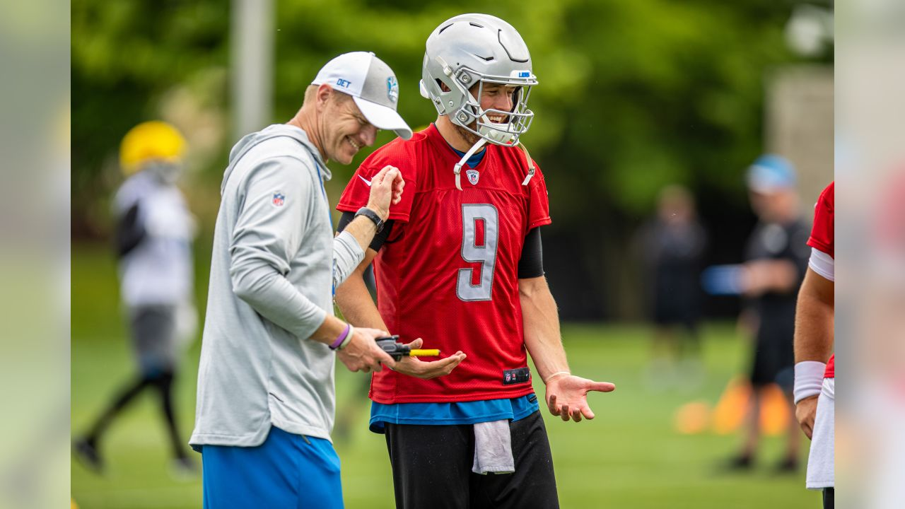 Detroit Lions quarterback Matthew Stafford (9) laughs with Detroit Lions offensive coordinator Darrell Bevell during Day 2 of minicamp on Wednesday, June 5, 2019 in Allen Park, Mich. (Detroit Lions via AP)