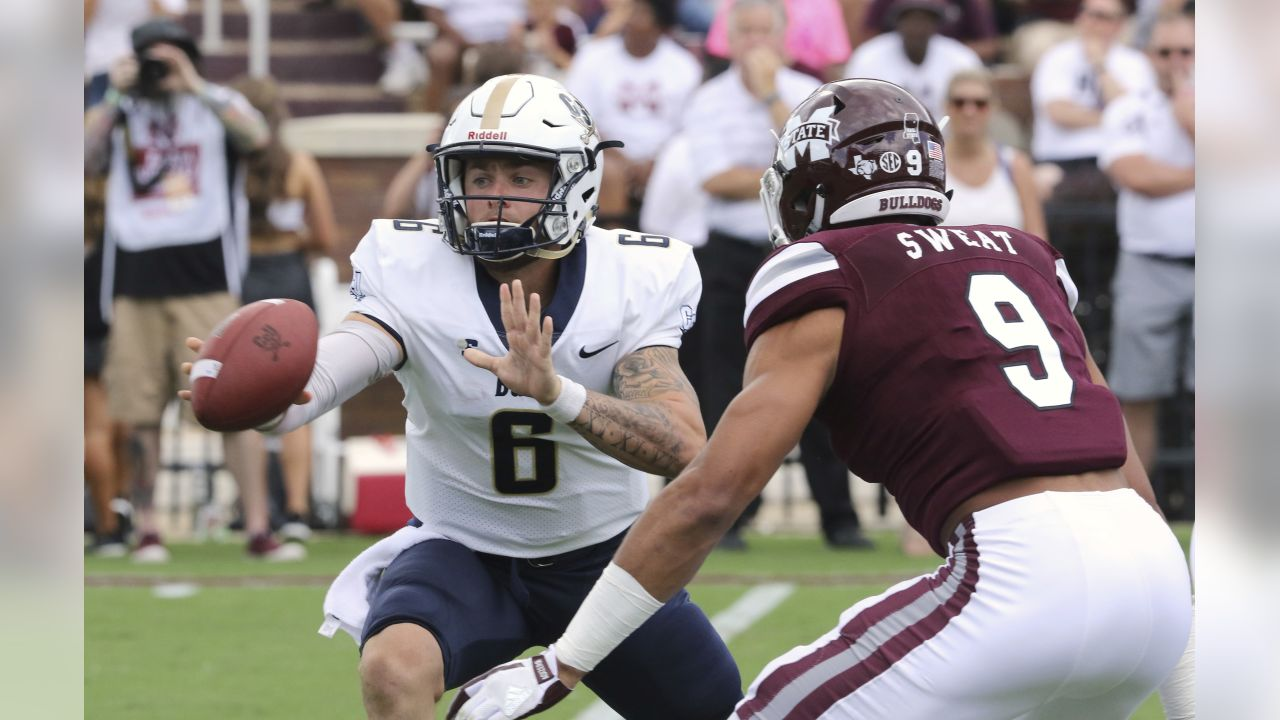 Charleston Southern quarterback Shane Bucenell (6) pitches the ball as Mississippi State defender Montez Sweat (9) puts pressure on him during the first half of an NCAA college football game in Starkville, Miss., Saturday, Sept. 2, 2017. (AP Photo/Jim Lytle)