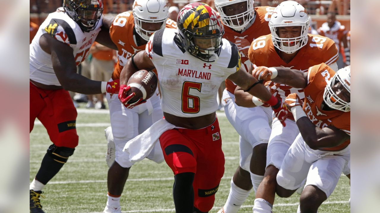 Maryland running back Ty Johnson (6) rushes the ball against the Texas defense during the second half of an NCAA college football game, Saturday, Sept. 2, 2017, in Austin, Texas. Maryland won 51-41. (AP Photo/Michael Thomas)