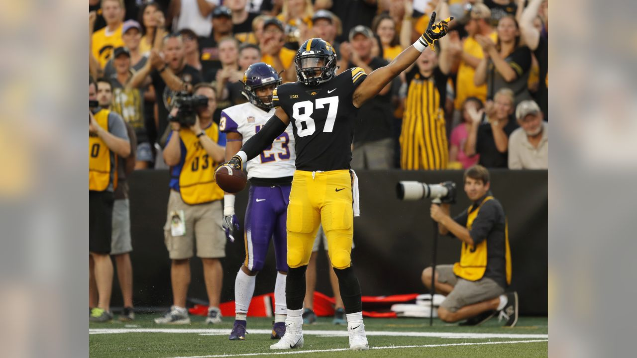 Iowa tight end Noah Fant (87) celebrates in front of Northern Iowa defensive back A.J. Allen, rear, after catching a 43-yard pass during the first half of an NCAA college football game, Saturday, Sept. 15, 2018, in Iowa City, Iowa. (AP Photo/Charlie Neibergall)