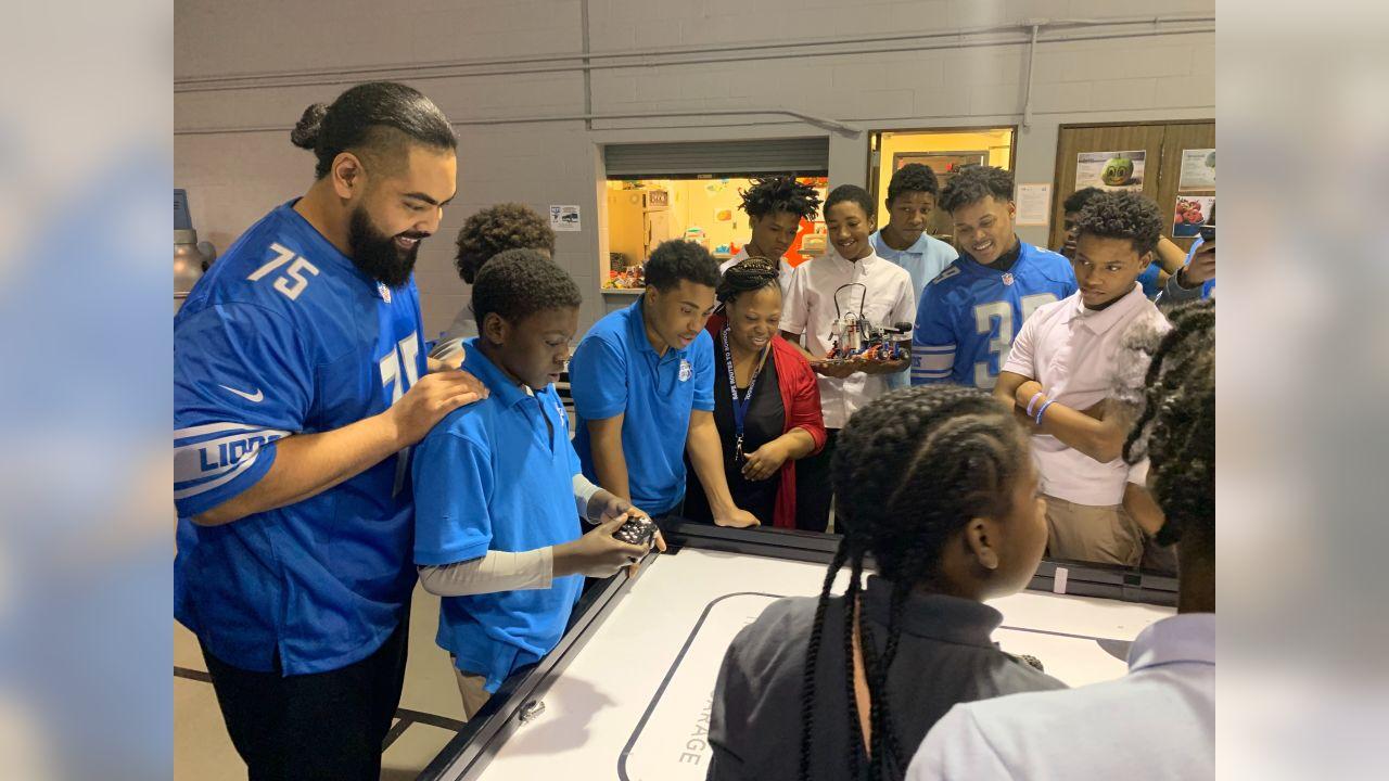 Detroit Lions center Leo Koloamatangi (75) and Detroit Lions cornerback Jamal Agnew (39) build robots with students at Detroit Lions Academy on Tuesday, Dec. 11, 2018 in Detroit.