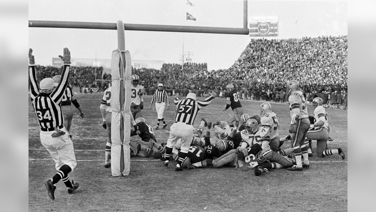 The officials signal a touchdown as quarterback Bart Starr (15) dives across the goal line for the game-winning touchdown in the Packers' 21-17 victory over the Dallas Cowboys in the NFL championship game at Lambeau Field on Dec. 31, 1967. Press-Gazette archives