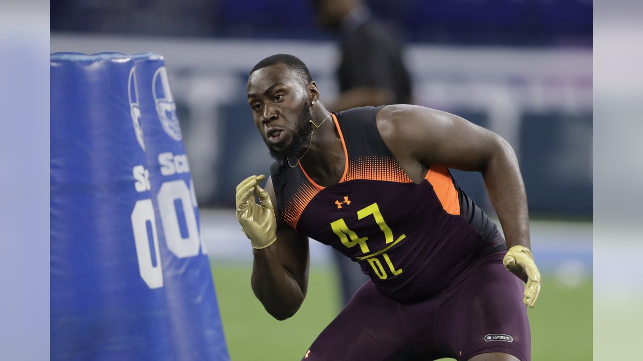 Texas defensive lineman Charles Omenihu runs a drill during the NFL football scouting combine, Sunday, March 3, 2019, in Indianapolis. (AP Photo/Darron Cummings)