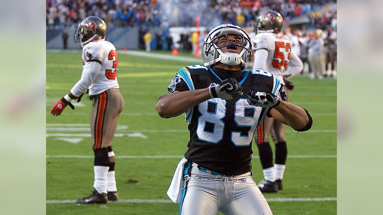 Carolina Panthers' Steve Smith (89) reacts after his game-winning five-yard touchdown catch as Tampa Bay Buccaneers players Corey Ivy (35) and Shelton Quarles (53) stand by during the final minutes of the fourth quarter of the Panthers' 27-24 win in Charlotte, N.C., Sunday, Nov. 9, 2003. (AP Photo/Rick Havner)