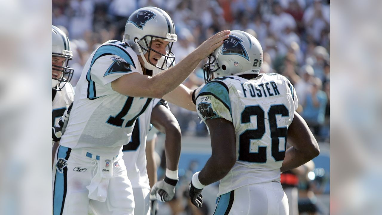 Carolina Panthers quarterback Jake Delhomme (17) celebrates with DeShaum Foster (26) after Foster's 43-yard touchdown run late in the fourth quarter of the Panthers' 21-18 win over the New Orleans Saints in an NFL football game in Charlotte, N.C., Sunday, Oct. 1, 2006. (AP Photo/Chuck Burton)