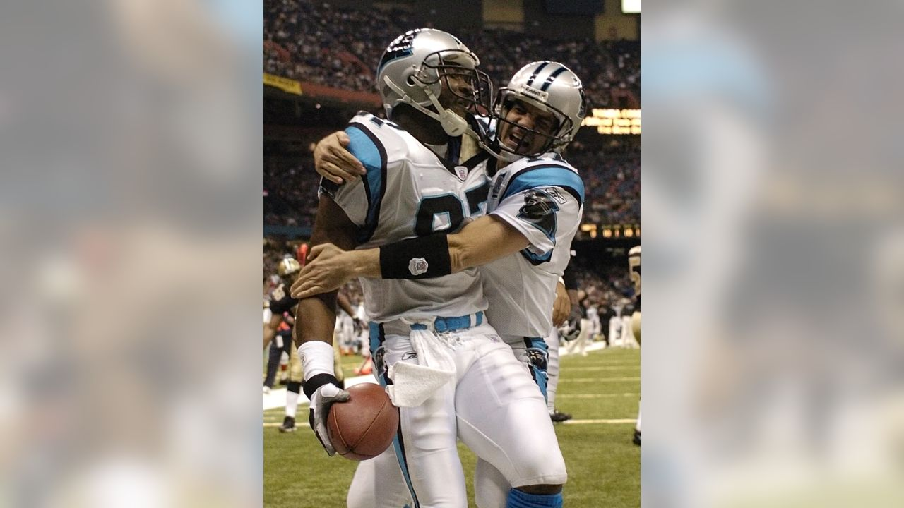 Carolina Panthers quarterback Jake Delhomme (17) congratulates wide receiver Muhsin Muhammad (87) after Muhammad caught his touchdown pass against the New Orleans Saints in the first half in the Louisiana Superdome in New Orleans on Sunday, Dec. 5, 2004.  (AP Photo/Alex Brandon)