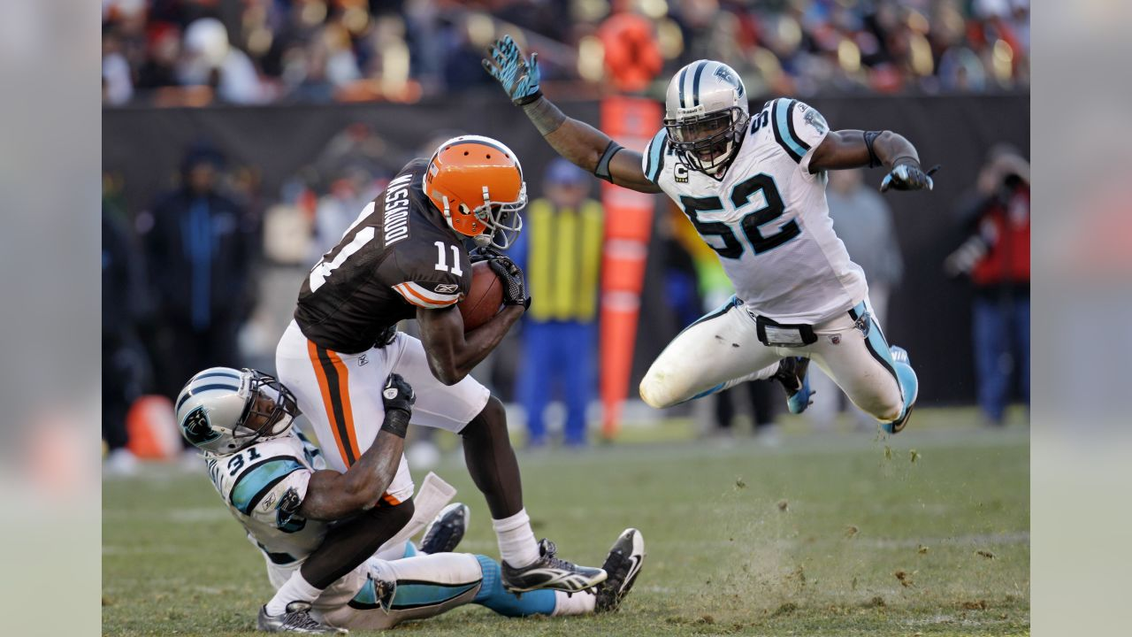 Cleveland Browns wide receiver Mohamed Massaquoi (11) runs the ball as he is tackled by Carolina Panthers cornerback Richard Marshall (31) in an NFL football game Sunday, Nov. 28, 2010, in Cleveland. Jon Beason (52) is on the right. (AP Photo/Tony Dejak)