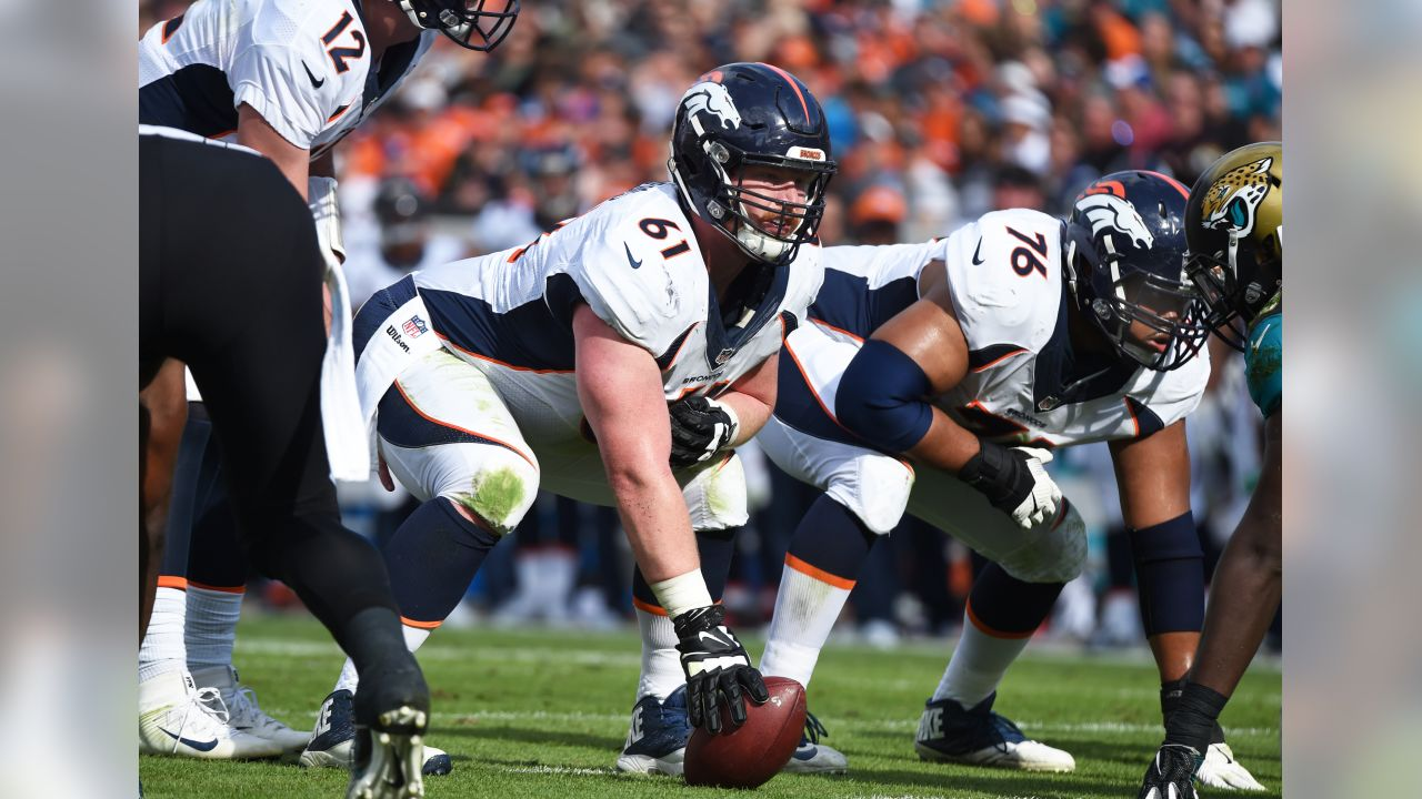 Denver Broncos center Matt Paradis (61) sets for play at the line of scrimmage against the Jacksonville Jaguars  Dec.4, 2016 during an NFL football game in Jacksonville, Fla. Denver won 20 - 10.  (Al Messerschmidt via AP)