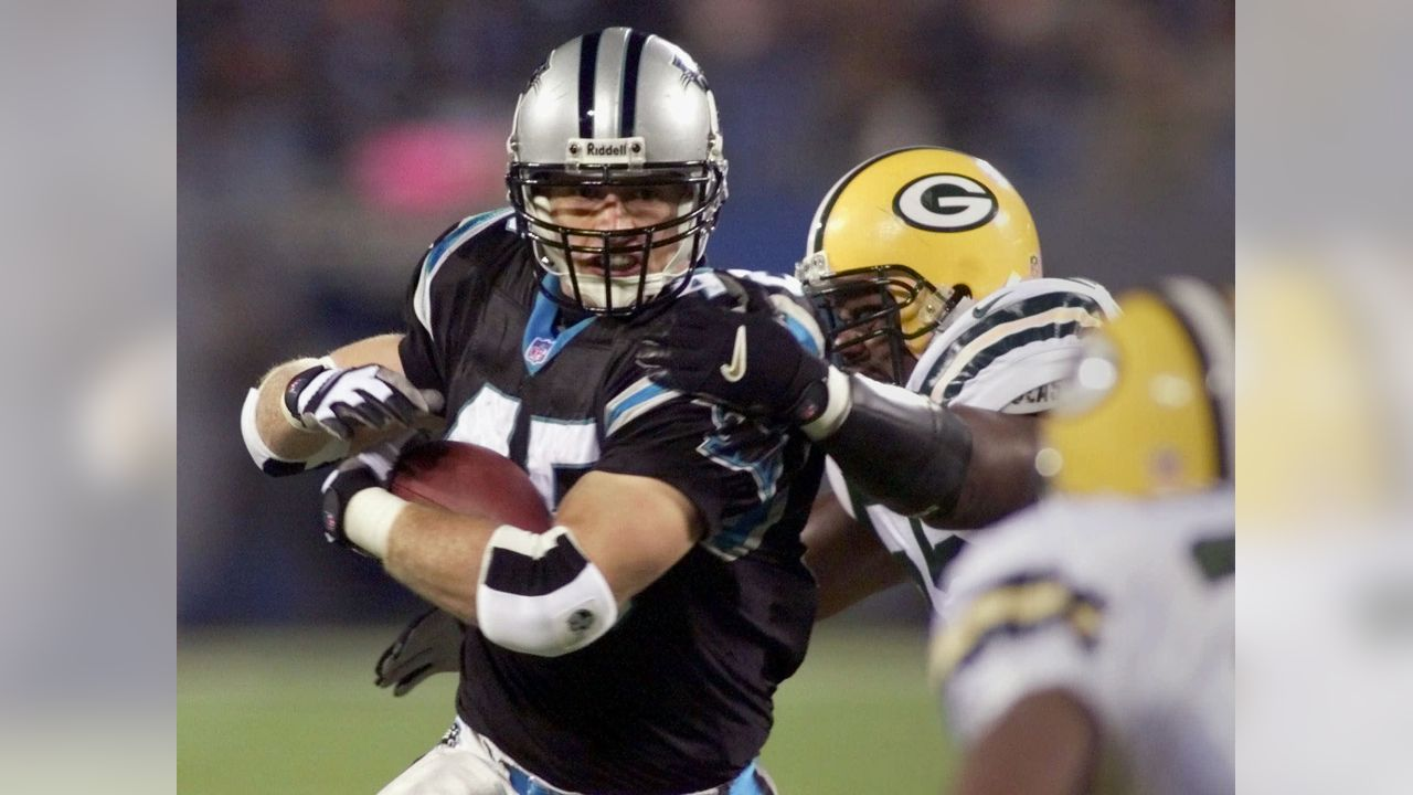 Carolina Panthers' Brad Hoover (45) breaks the tackle of Green Bay Packers' Bernardo Harris (55) in the second quarter at Ericsson Stadium in Charlotte, N.C., Monday Nov. 27, 2000. (AP Photo/Chuck Burton)