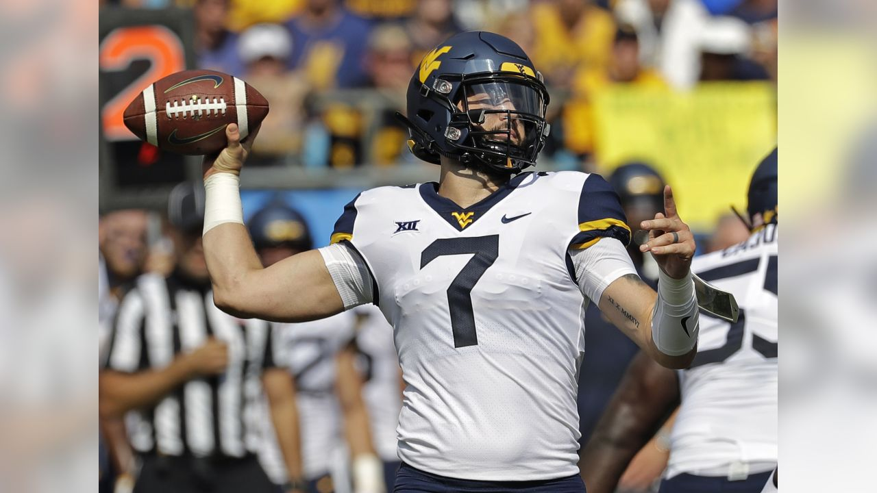 FILE - In this  Saturday, Sept. 1, 2018 file photo, West Virginia's Will Grier (7) looks to pass against Tennessee in the first half of an NCAA college football game in Charlotte, N.C. Grier injured his hand in during the play and left the game. Grier says he won't use a season-ending injury he suffered last season against Texas as additional motivation when No. 12 West Virginia plays the 15th-ranked Longhorns on Saturday, Nov. 3, 2018 in Austin, Texas. (AP Photo/Chuck Burton, File)