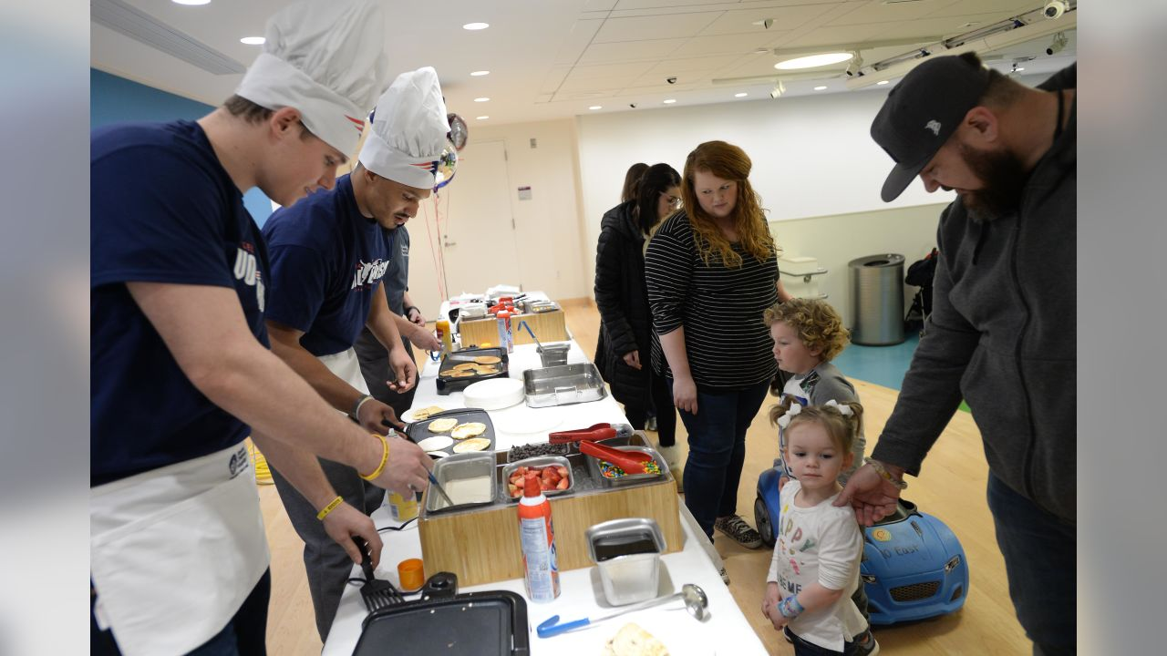 BOSTON, MA - MARCH 12: New England Patriot's Ryan Izzo (L) and Derek Rivers flip pancakes for the kids at Boston Children's Hospital March 12, 2019 in Boston, Massachusetts. (Photo by Darren McCollester/Getty Images for Boston Children's Hospital)