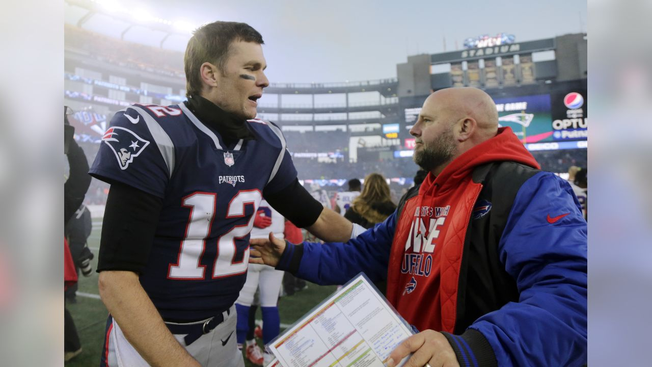 New England Patriots quarterback Tom Brady, left, and Buffalo Bills offensive coordinator Brian Daboll, who formerly coached at the Patriots, speak at midfield after an NFL football game, Sunday, Dec. 23, 2018, in Foxborough, Mass. (AP Photo/Elise Amendola)