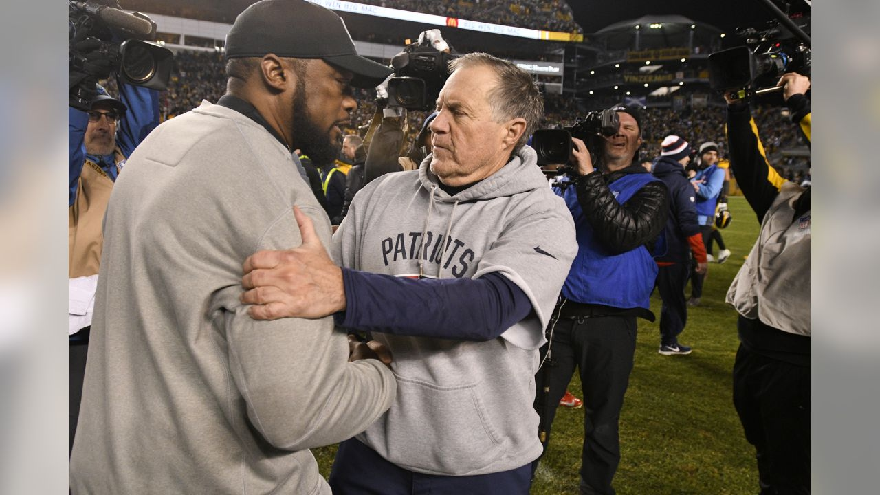 Pittsburgh Steelers head coach Mike Tomlin, left, and New England Patriots head coach Bill Belichick talk on the field following an NFL football game in Pittsburgh, Sunday, Dec. 16, 2018. The Steelers won 17-10. (AP Photo/Don Wright)