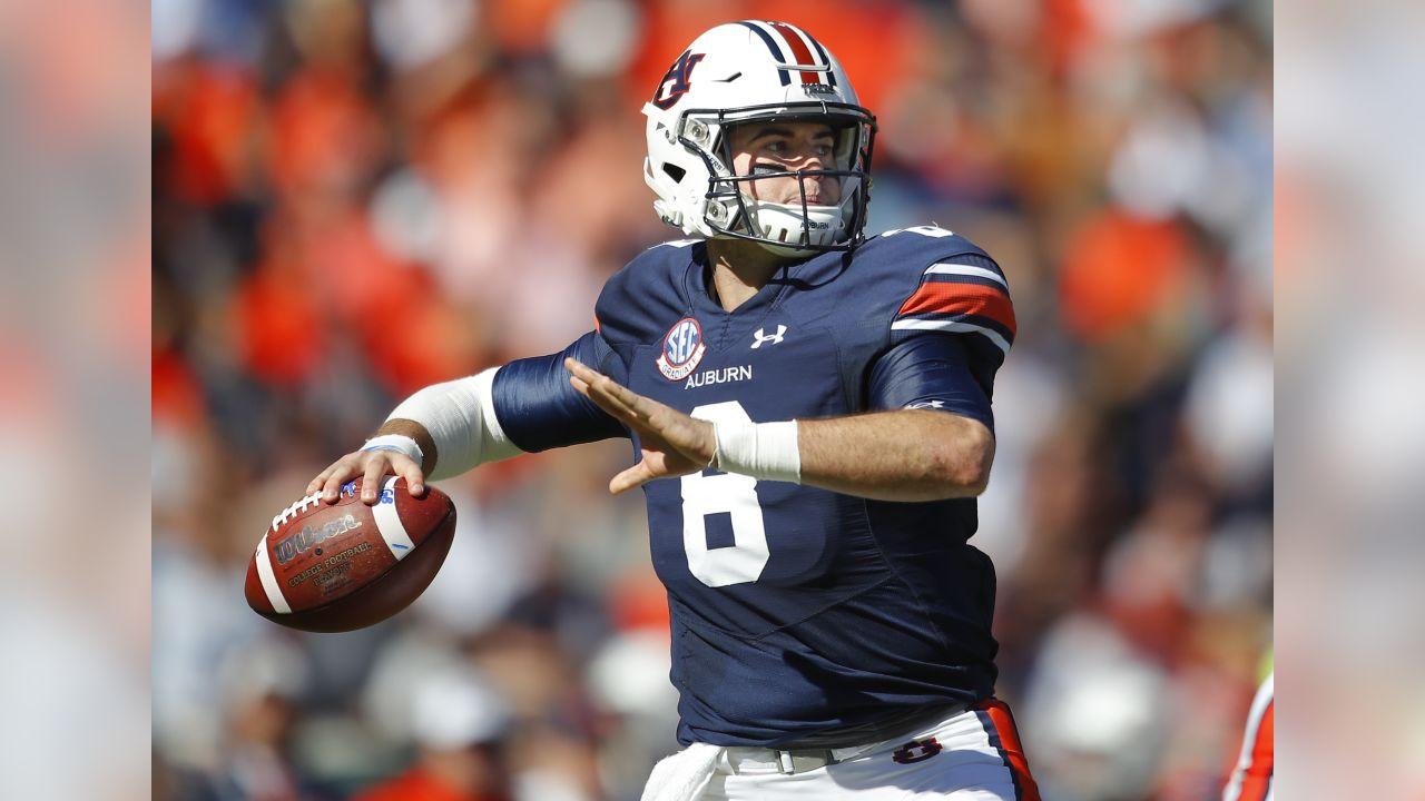 Auburn quarterback Jarrett Stidham (8) drops back to pass against Texas A&M during the first half of an NCAA college football game in Auburn, Ala.