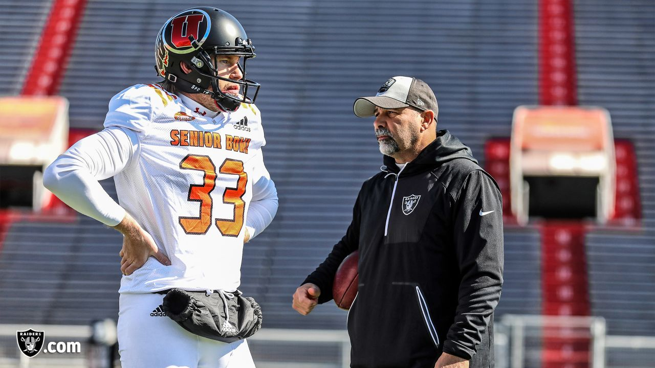 Utah punter Mitch Wishnowsky (33) and Oakland Raiders assistant head coach and special teams coordinator Rich Bisaccia at a practice on Day 3 of the 2019 Senior Bowl at Ladd-Peebles Stadium, Thursday, January 24, 2019, in Mobile, Alabama.