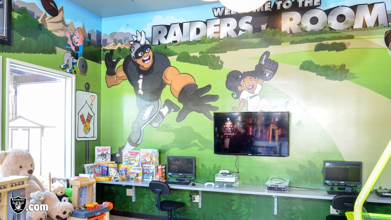 The Raiders, represented by alumnus Chris McLemore and the Raiderettes, help remodel the Ronald McDonald House Charities playroom (RMHC) and give the RMHC van a facelift for families and children receiving inpatient and outpatient medical treatment at local hospitals who live more than 30 miles outside the Greater Las Vegas Area, Tuesday, October 30, 2018, in Las Vegas, Nevada.