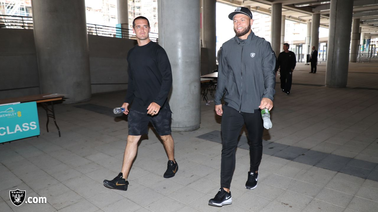 Oakland Raiders quarterback Derek Carr (4) and safety Erik Harris (25) arrive at Wembley Stadium for a walk through before their game against the Seattle Seahawks, Saturday, October 13, 2018, in London, England.