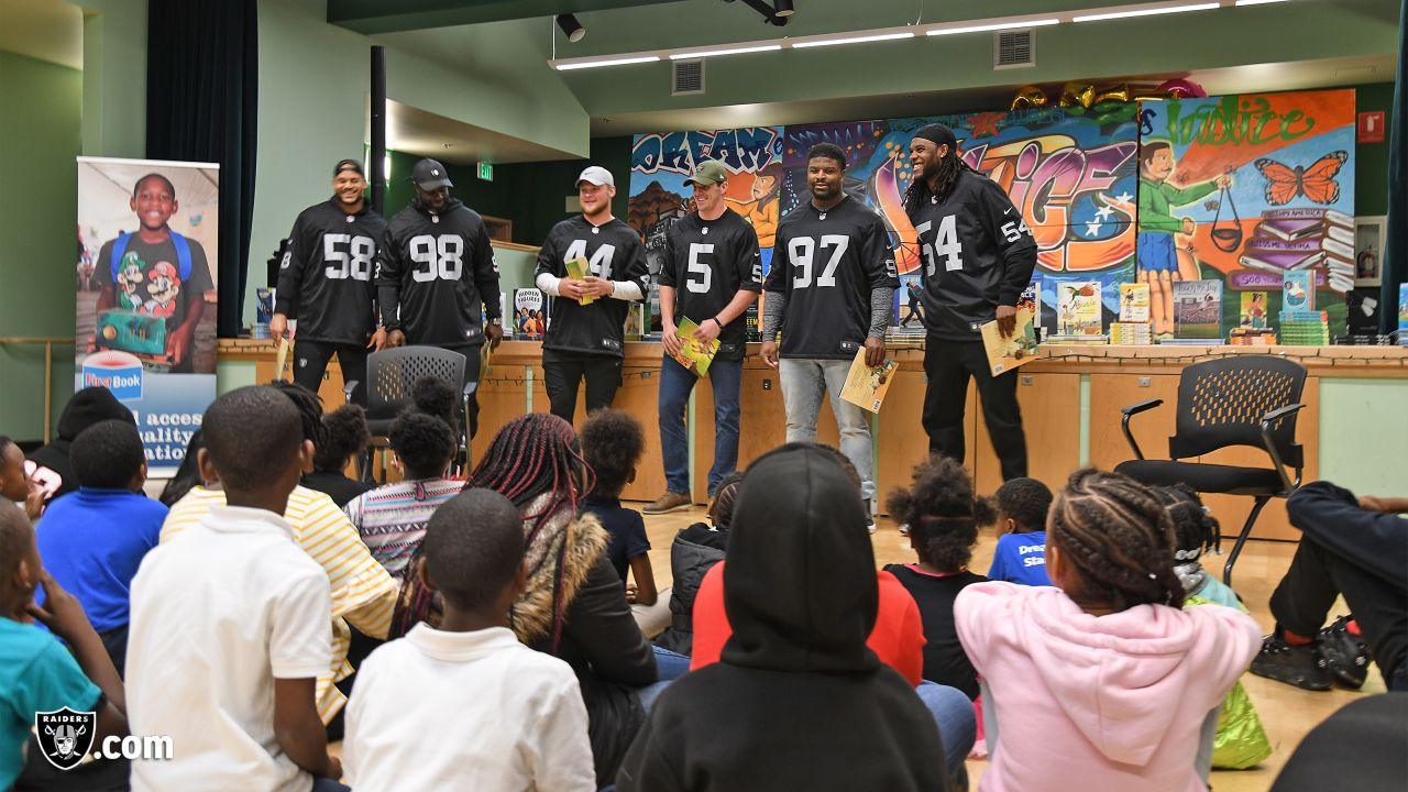 Oakland Raiders defensive tackle Clinton McDonald and his Light Into Darkness Foundation, along with linebacker Emmanuel Lamur, linebacker Kyle Wilber, punter Johnny Townsend, defensive tackle Frostee Rucker, and fullback Ryan Yurachek, partner with the nonprofit First Book by hosting a reading party to promote literacy at the West Oakland Youth Center, Tuesday, December 11, 2018, in Oakland, California.