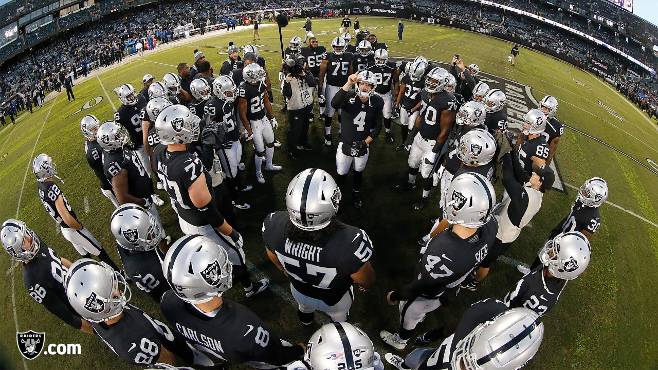 Oakland Raiders quarterback Derek Carr (4) huddles with the team before the Oakland Raiders game against the Denver Broncos at Oakland-Alameda County Coliseum, Monday, December 24, 2018, in Oakland, California.  Oakland won 27-14.
