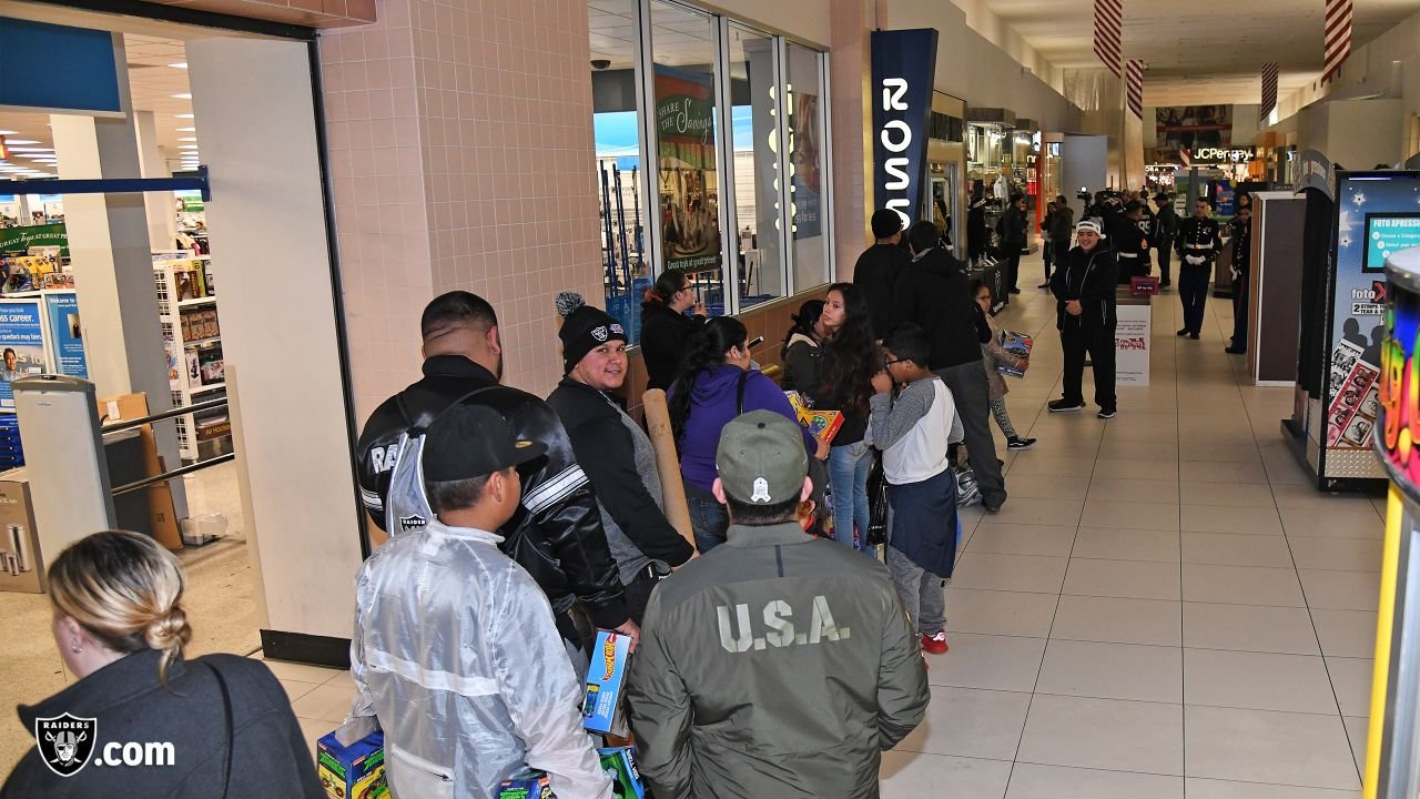 The Raiders Foundation hosts a Toys for Tots drive where guests have the chance to meet Oakland Raiders linebacker Jason Cabinda (53), linebacker Marquel Lee (55), and defensive tackle Maurice Hurst (73) in exchange for a toy or $20 donation to the charity, Tuesday, December 4, 2018, in Hayward, California.