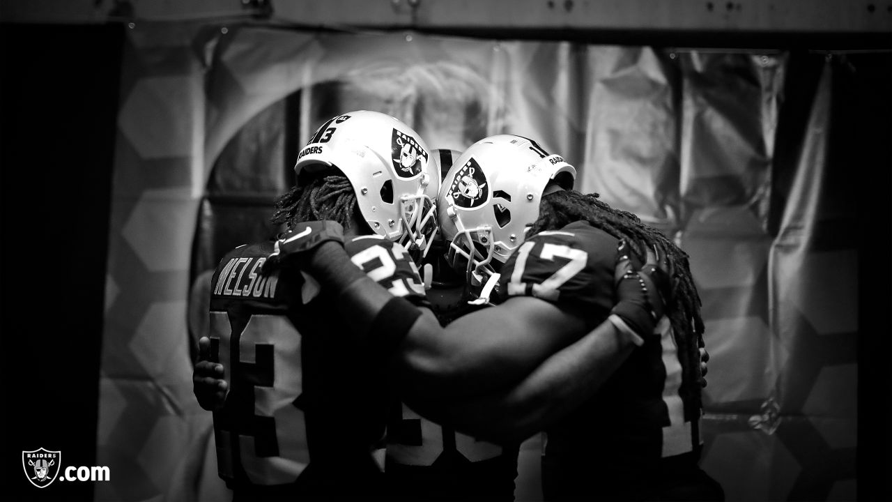 Oakland Raiders cornerback Nick Nelson (23), Jalen Richard and Dwayne Harris join the huddle before the Oakland Raiders regular season game against the Pittsburgh Steelers at Oakland Alameda-County Coliseum on Sunday, December 9th, 2018, in Oakland, California. The Oakland Raiders won 24-21.
