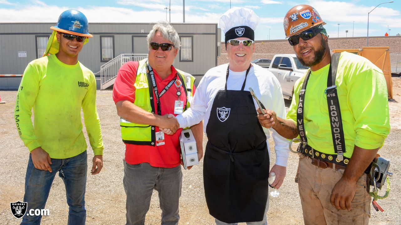 Oakland Raiders owner, Mark Davis, and other staff members from The Oakland Raiders front office spend the day with construction workers of the Las Vegas Stadium worksite by handing out lunches and sharing a meal, Wednesday, June 28, 2018, at the Las Vegas Stadium worksite in Las Vegas, Nevada.