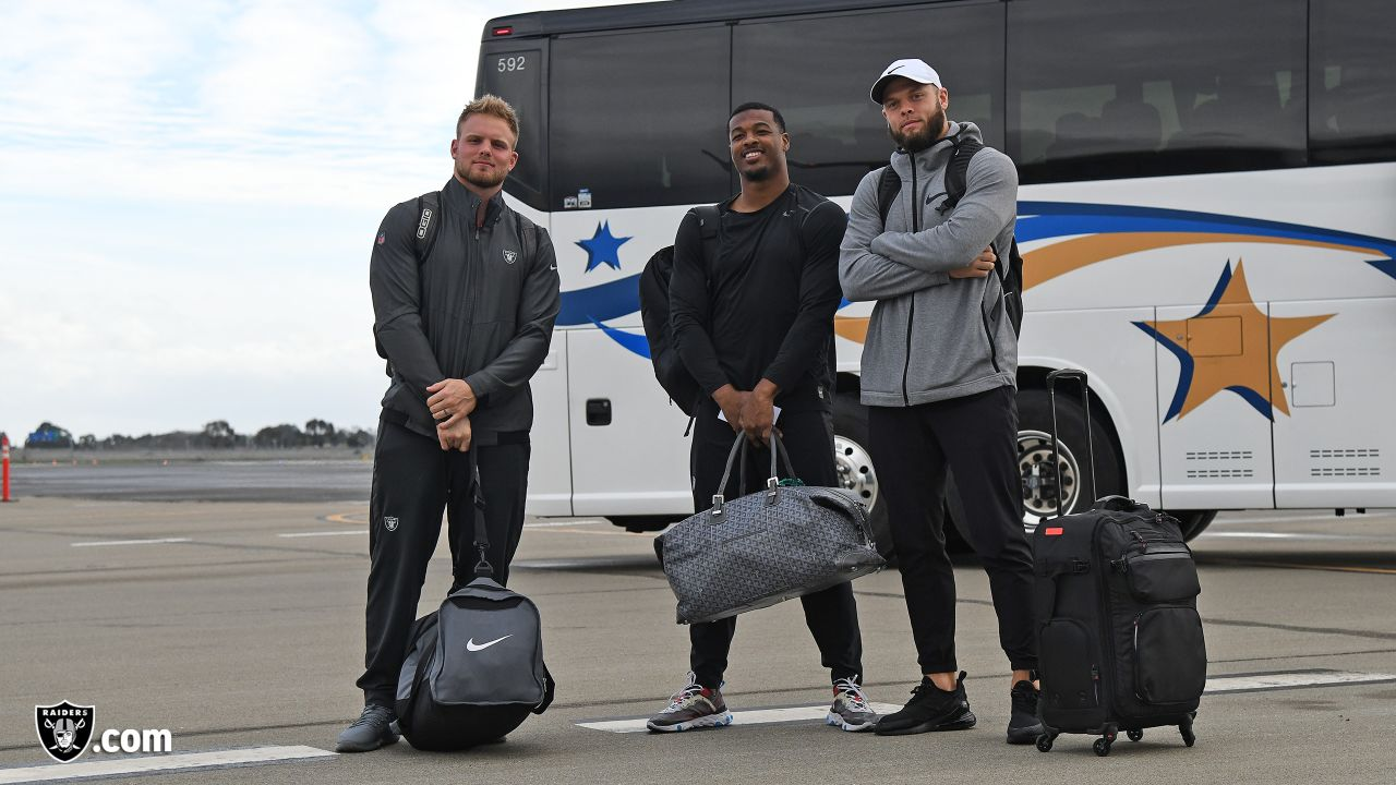 Oakland Raiders safety Dallin Leavitt (32), safety Marcus Gilchrist (31), and safety Erik Harris (25) depart for their game against the Cincinnati Bengals, Friday, December 14, 2018, in Oakland, California.