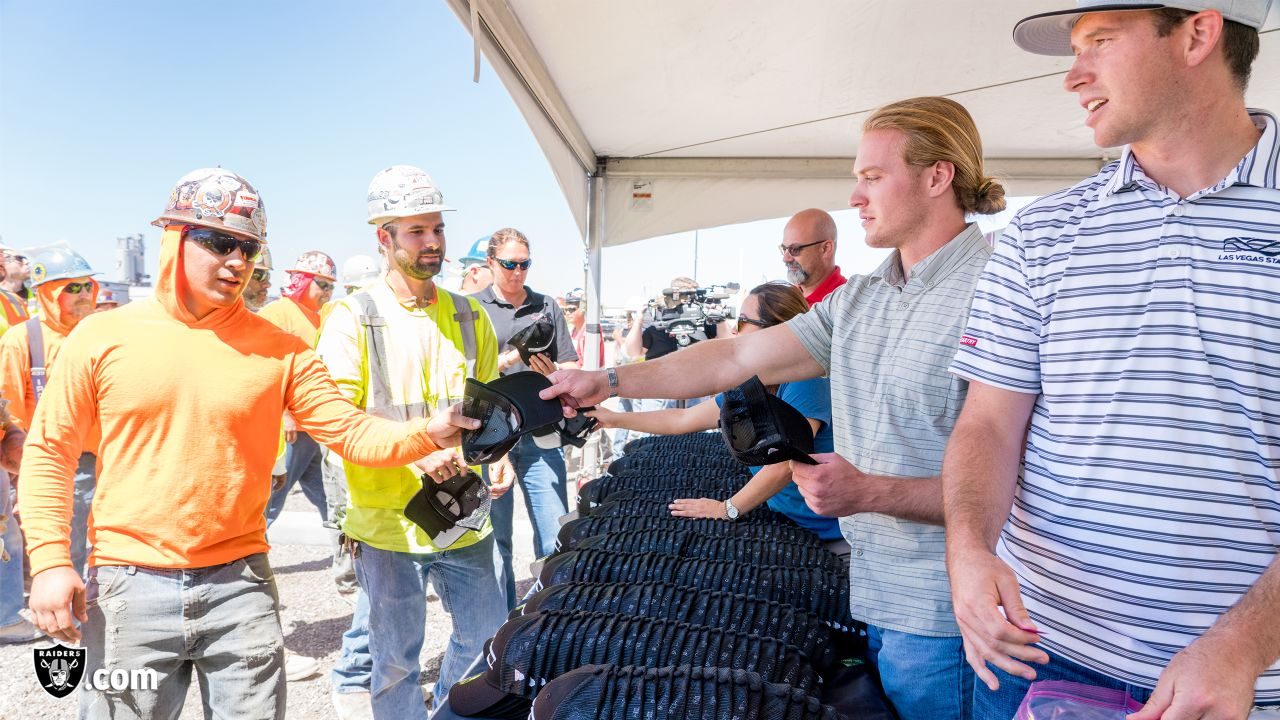 Executives and staff members from the Oakland Raiders front office spend the day with construction workers of the Las Vegas Stadium worksite by handing out lunches and sharing a meal, Thursday, June 27, 2019, at the the Las Vegas Stadium worksite in Las Vegas, Nev.