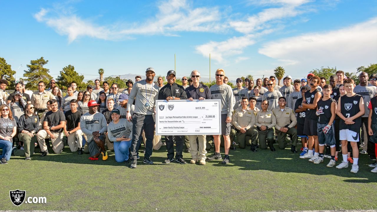 The Raiders, represented by alumnus Leo Gray, collaborate with the Las Vegas Metro Police Activities League to start a 7-on-7 NFL FLAG Passing League for high school junior varsity athletes, Saturday, April 20, 2019, at Rancho High School in Las Vegas, Nev.