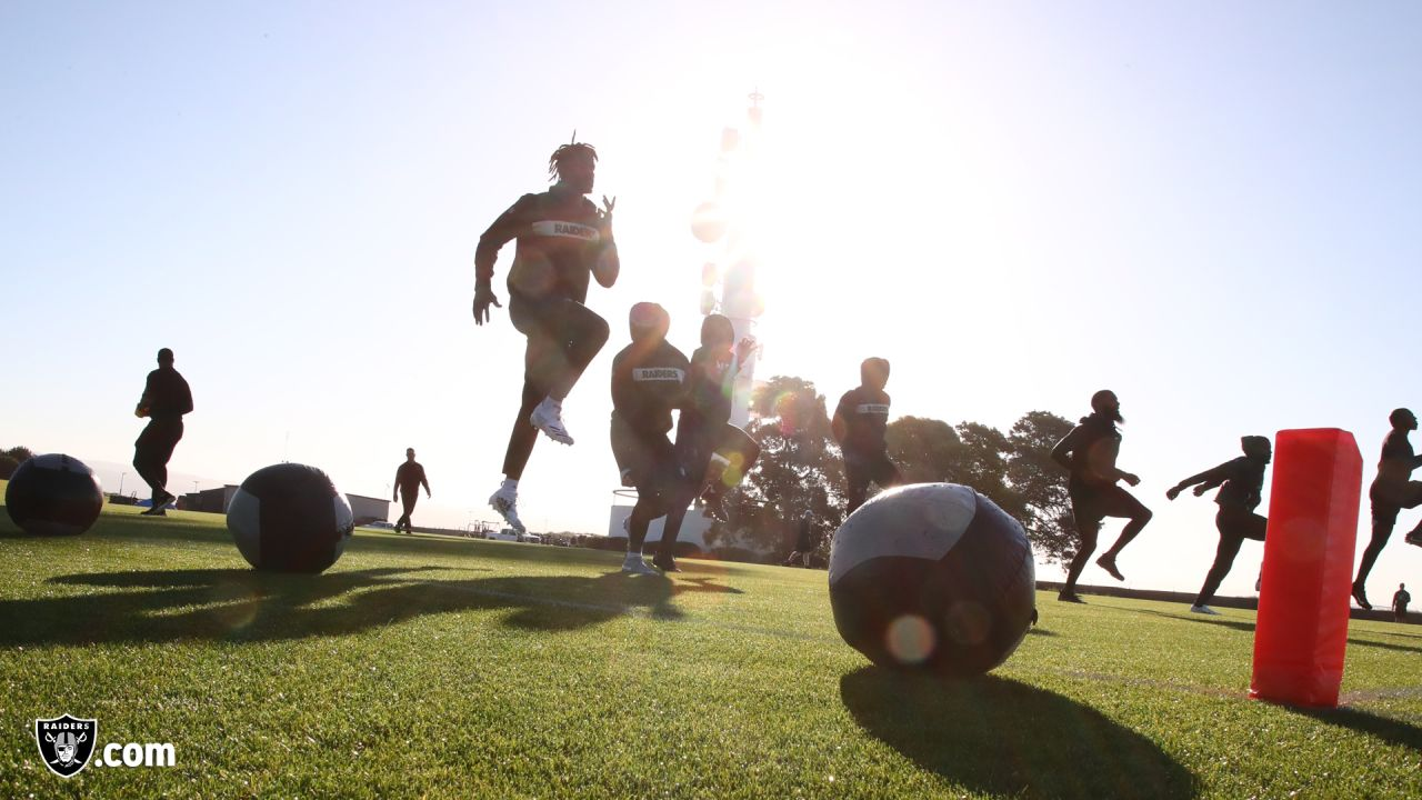 Raiders players and coaches at a workout during phase one of the offseason program at the Raiders Practice Facility in Alameda, Calif.