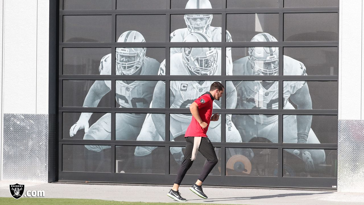 Oakland Raiders quarterback Derek Carr (4) on the field for a walk through before their game against the Indianapolis Colts, Wednesday, October 31, 2018, in Alameda, California.