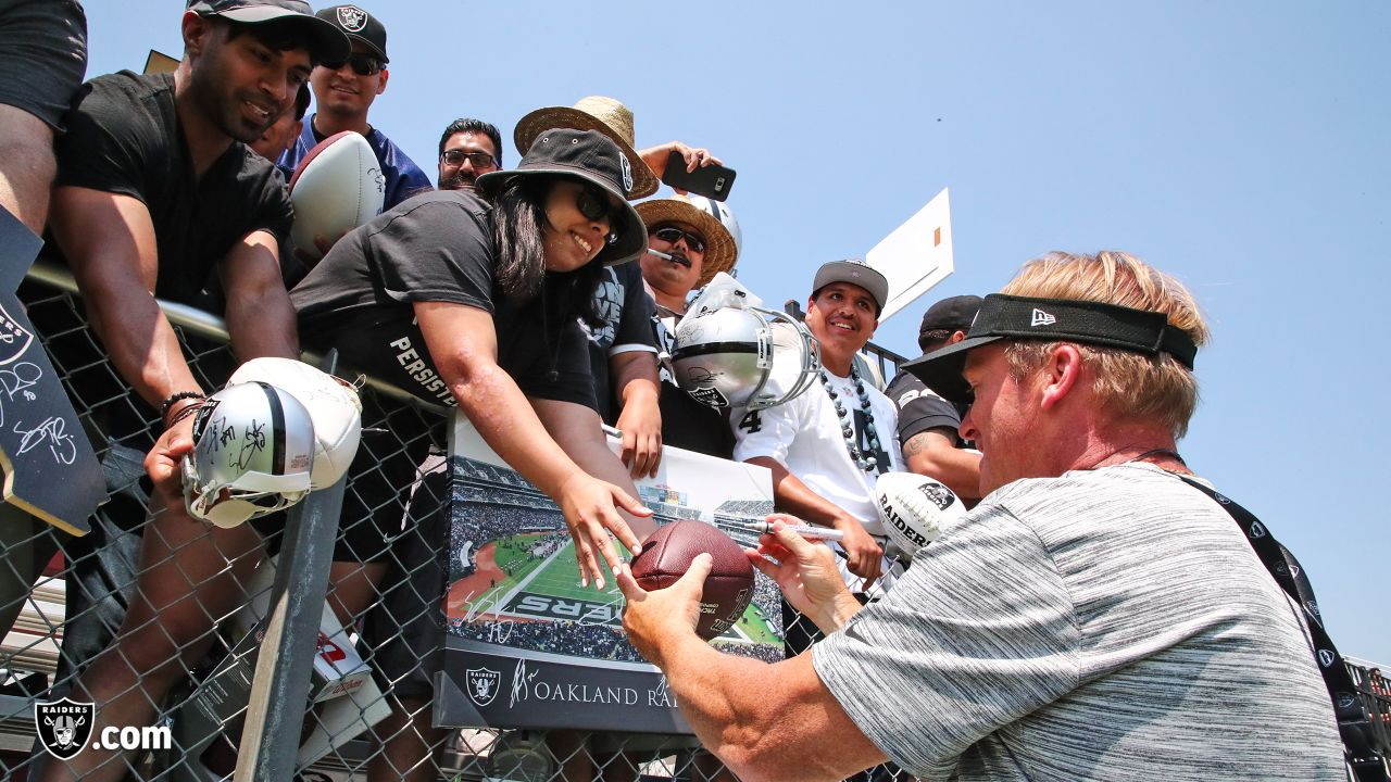 Oakland Raiders head coach Jon Gruden signs autographs for fans after practice at 2018 Training Camp at Memorial Stadium, Saturday, July 28, 2018, in Napa, California.