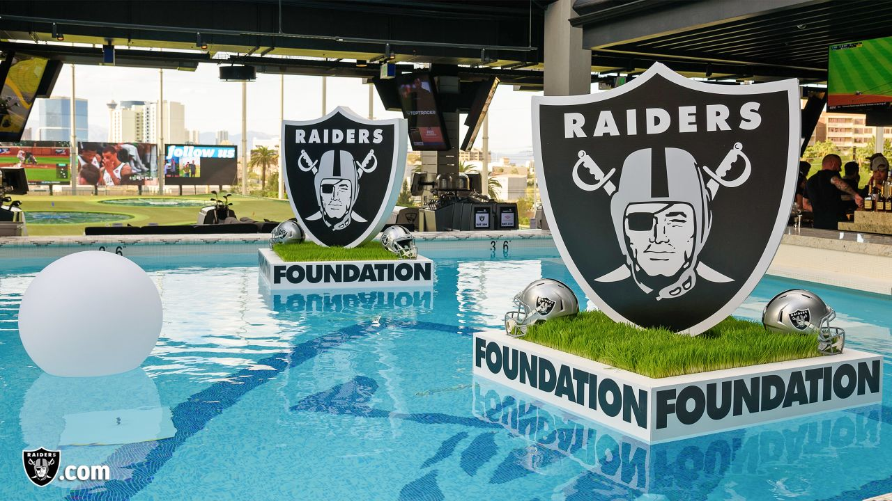 Guests join Raiders alumni, current players, and other Raiders personalities for an evening of golf, food, and beverages at Topgolf Las Vegas, Wednesday, May 8, 2019, in Las Vegas, Nev. All proceeds go to Communities in Schools of Southern Nevada.