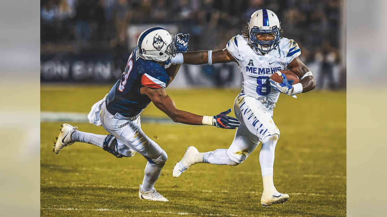Memphis running back Darrell Henderson (8) fends off Connecticut linebacker Vontae Diggs (13) during the second half of an NCAA college football game, Friday, Oct. 6, 2017, in East Hartford, Conn. (AP Photo/Jessica Hill)