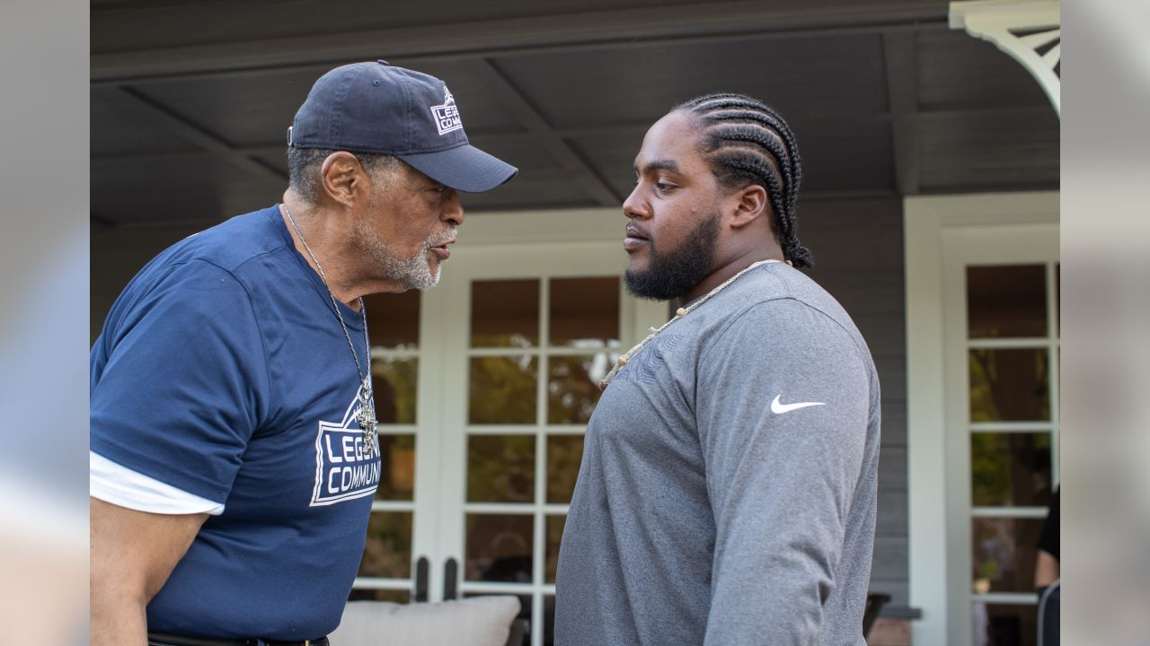 Defensive tackle (65) Bryant Jones of the Los Angeles Rams speaks to Rosie Grier at a BBQ/Social at Eric Dickerson's home, Tuesday, June 11, 2019, in Calabasas, CA. (Jeff Lewis/Rams)
