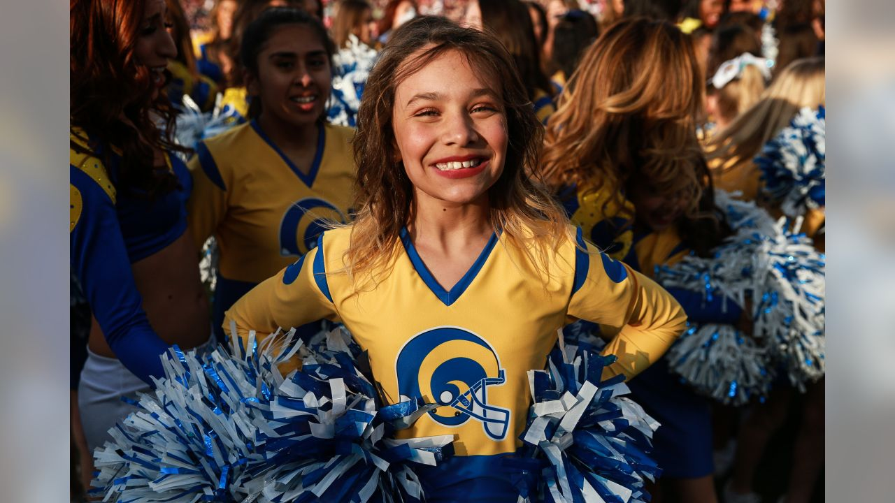 The Los Angeles Rams Cheerleaders perform during halftime along side the Junior Cheer squad as the Los Angeles Rams face off against the San Francisco 49ers at the Los Angeles Memorial Coliseum, the Rams win 48-32 in an NFL Week 17 game, Sunday, December 30, 2018, Los Angeles, CA. (Will Navarro/Rams)