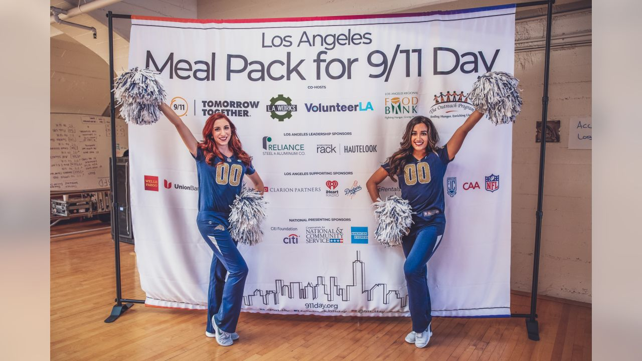 Cheerleaders volunteer their time by packing meals for the hungry in honor of 9/11 in Los Angeles, CA on Sept 11th, 2018 (Rams/Hiro Ueno).